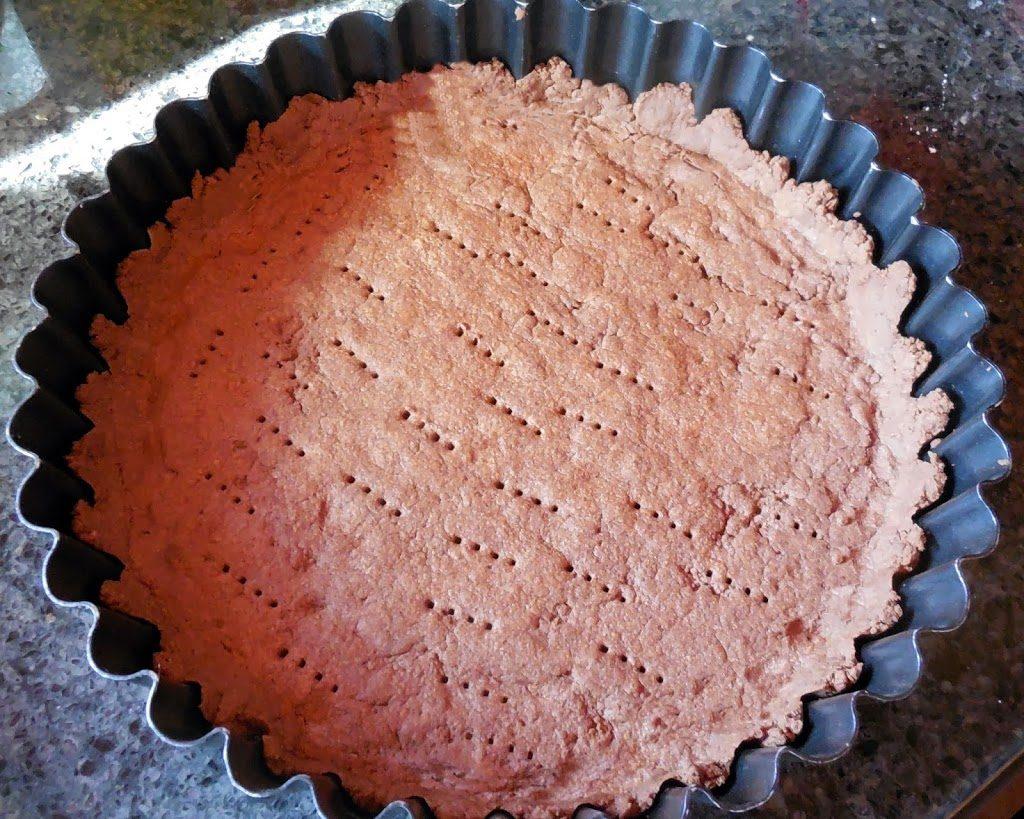 pierce tart dough with fork