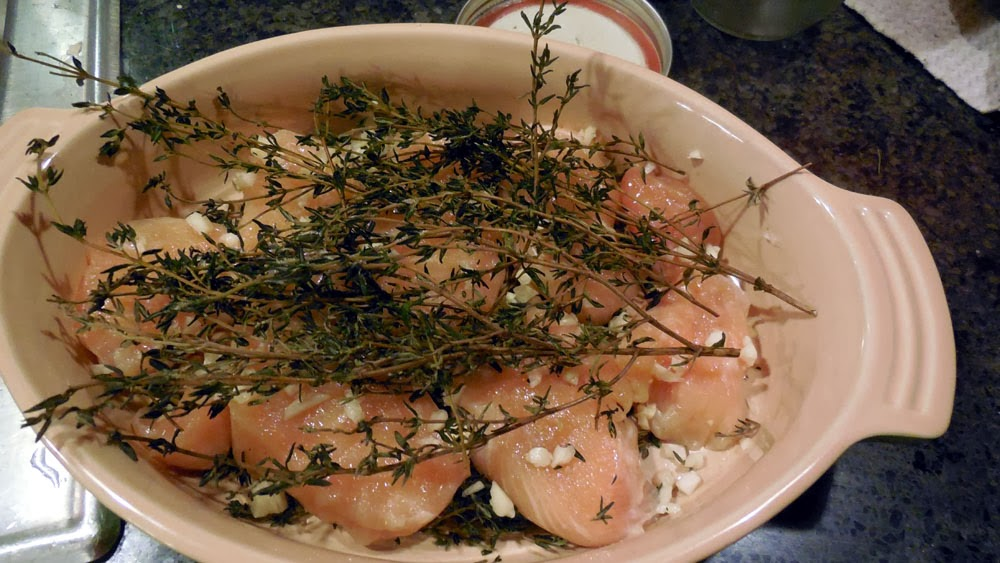 chicken breast with thyme in baking dish