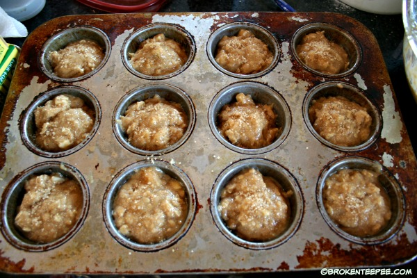 add apple oatmeal muffin batter to muffin tins