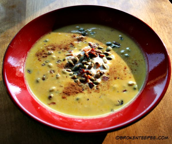 ginger carrot soup with yogurt and pumpkin seeds