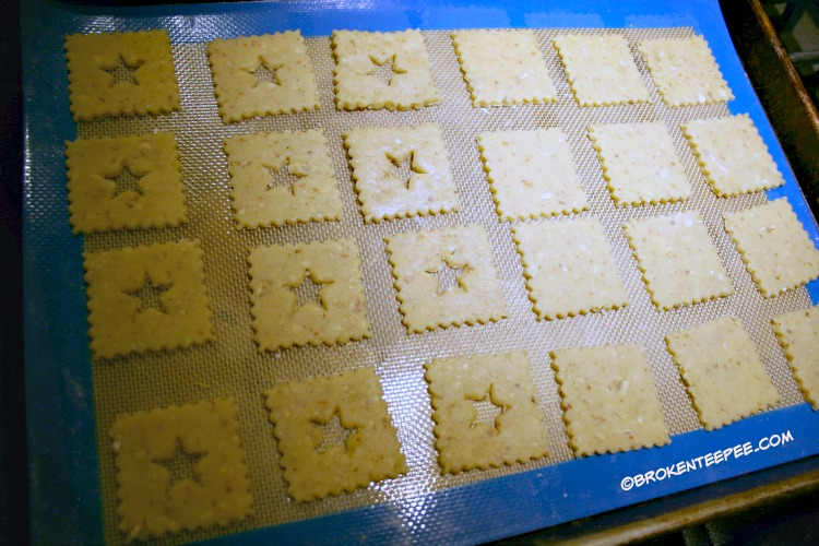 Holiday cookies, Linzer tarts, put cut outs on cookie sheet