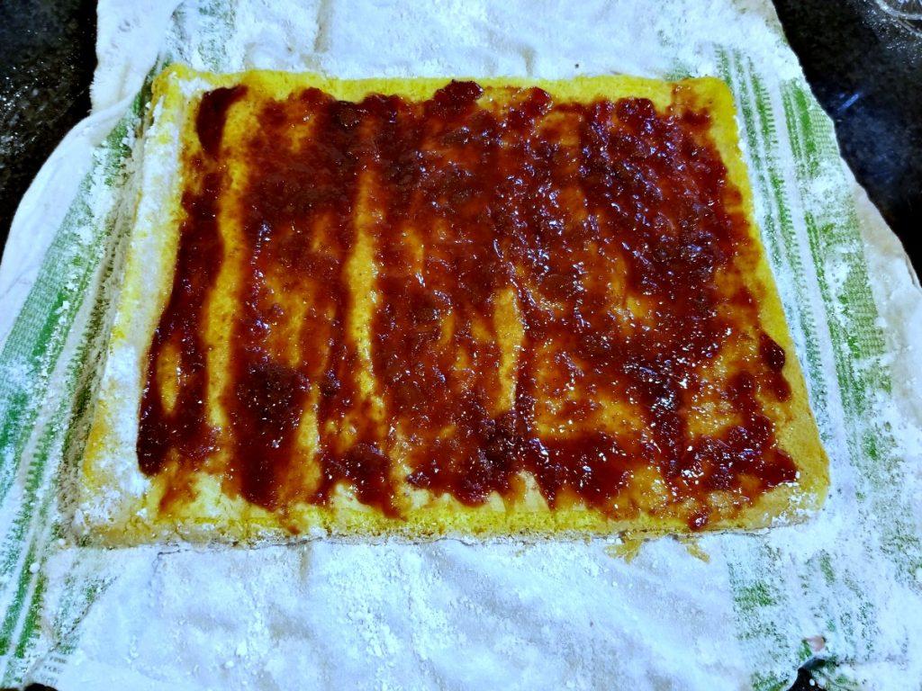 spread jam on cake