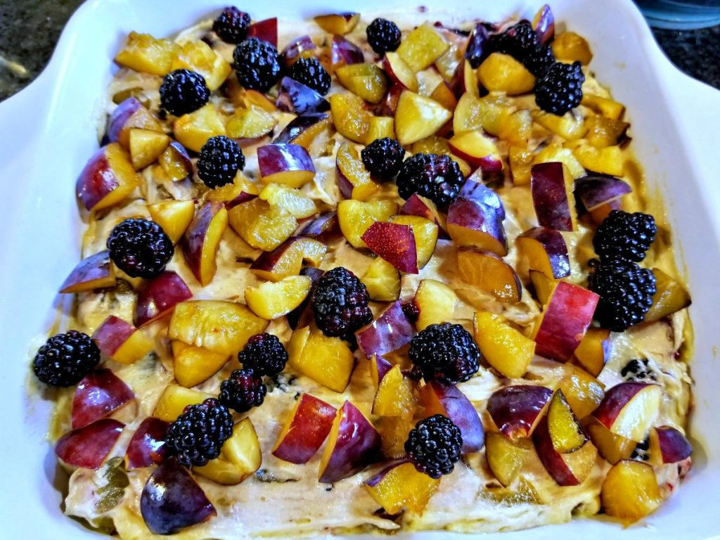 add remaining fruit to batter in pan