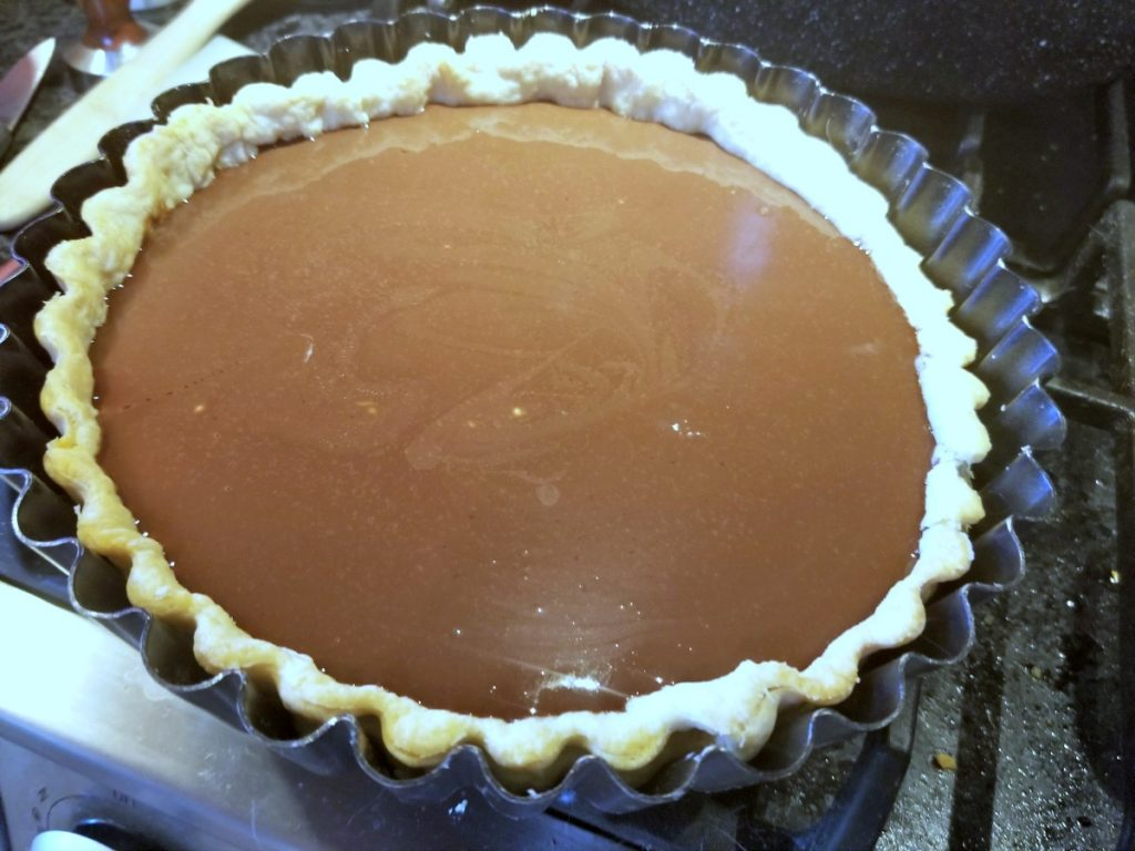 fill tart shell with chocolate filling
