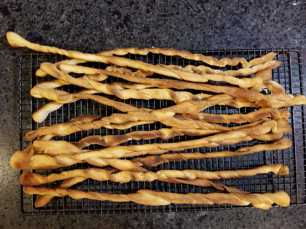 cool homemade breadsticks on wire rack