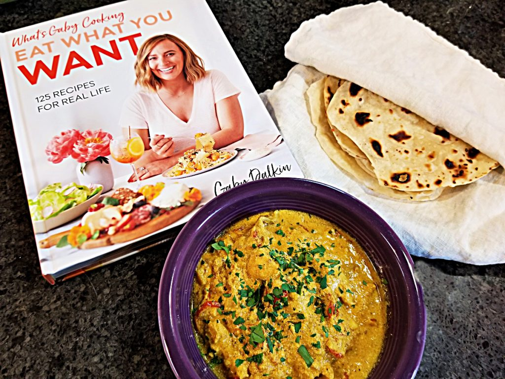 butter chicken and roti with cookbook