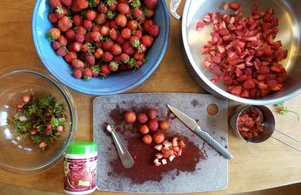 cut strawberries and cherries