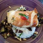 prosciutto wrapped chilean sea bass on basil grits with roasted eggplant
