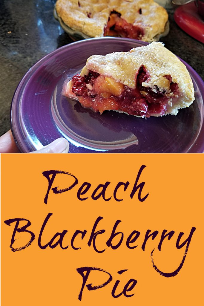 slice of peach blackberry pie in front of  the rest of the pie