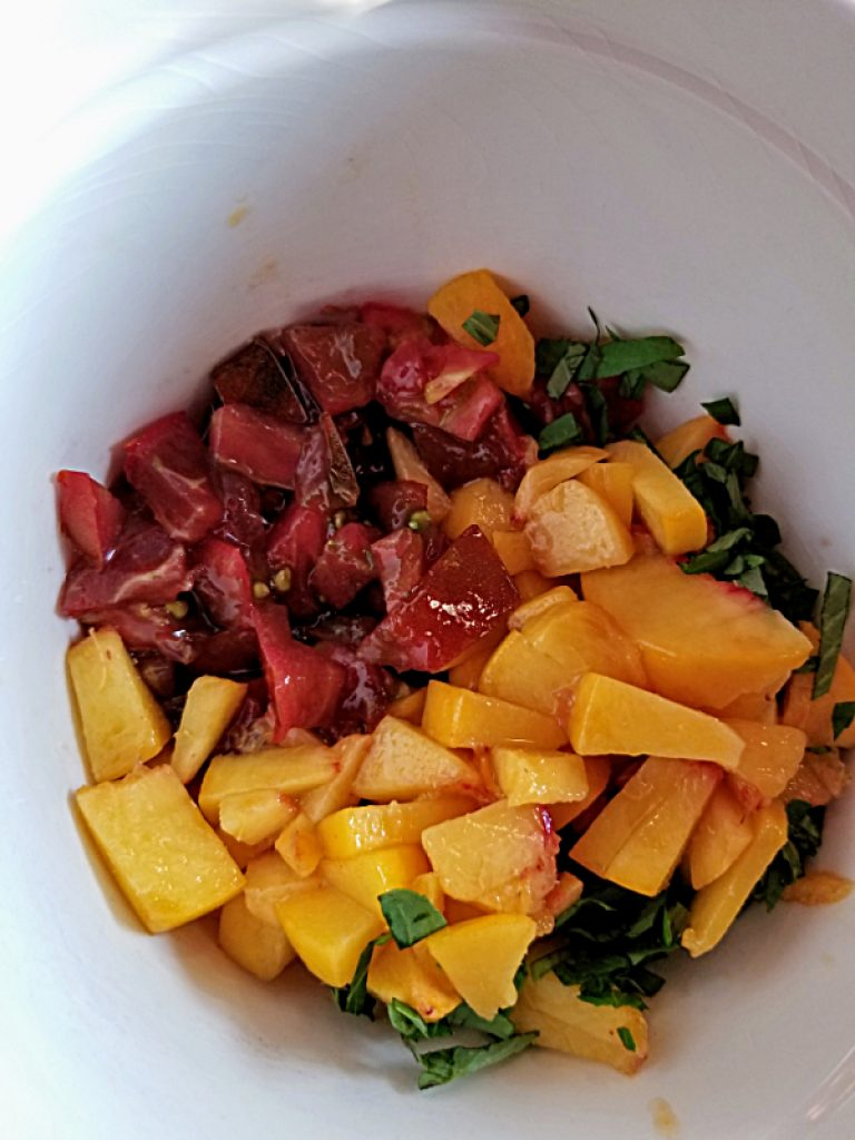 add basil to peaches and tomatoes