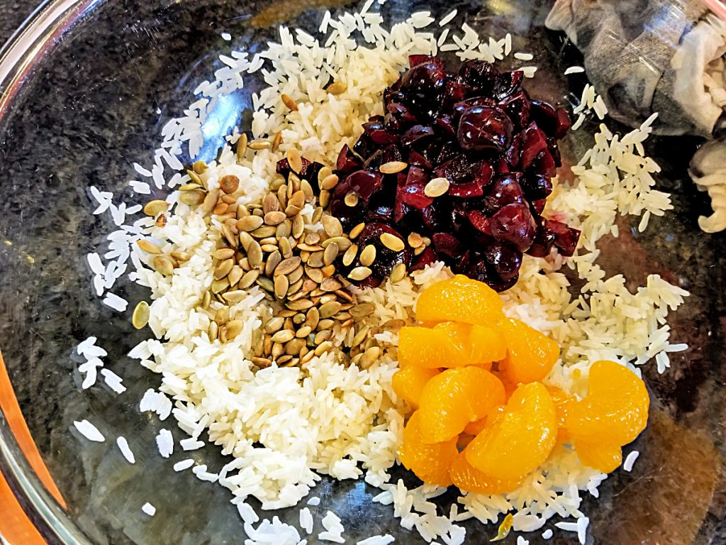 add ingredients for rice salad to bowl