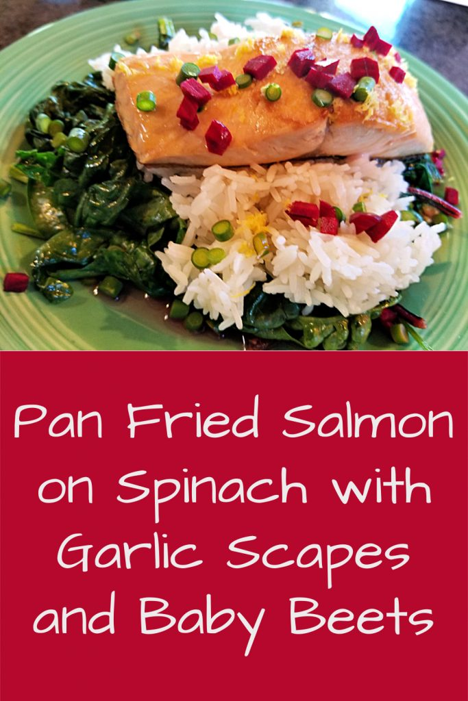 pan fried salmon on spinach